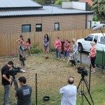 crew filming in the vet backyard puppy classes